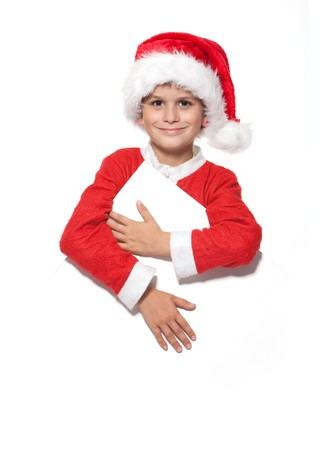 Boy holding a christmas poster isolated on white background photo