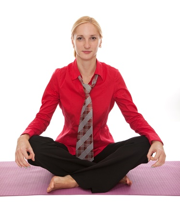 Practicing Yoga. Young businesswoman isolated on white background photo