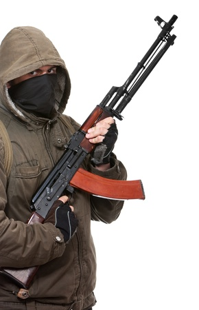 Terrorist with weapon on a white background Stock Photo - 8430273