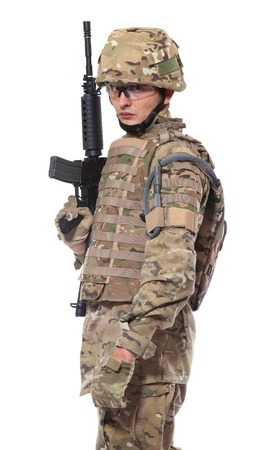 Modern soldier with rifle isolated on a white background Stock Photo - 8477725