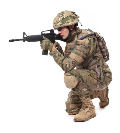Modern soldier with rifle isolated on a white background photo