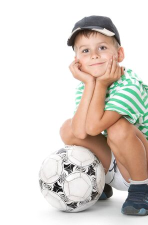 balls kids: Boy holding soccer ball  isolated on white background