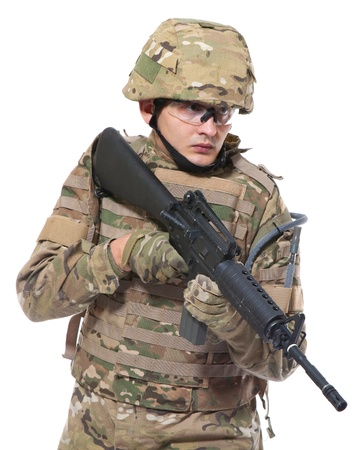 army uniform: Modern soldier with rifle isolated on a white background
