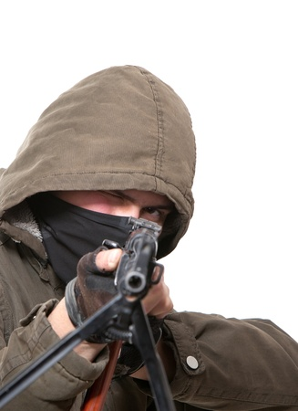 Terrorist with weapon on a white background Stock Photo - 8551300