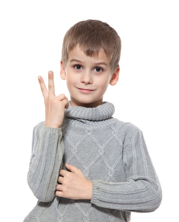 two persons only: Cute boy smilling isolated on a white background Stock Photo