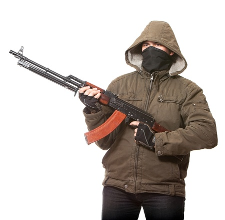 Terrorist with weapon on a white background Stock Photo - 8745095