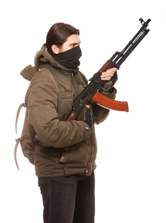 Terrorist with weapon on a white background Stock Photo - 8745074