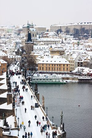 Winter in Prague looking over the Charles Bridge to the Castle Stock Photo - 8745123