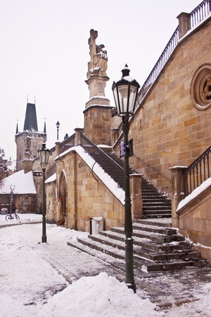 View of the gate at the end of the Charles Bridge in Prague, Czech Republic  photo