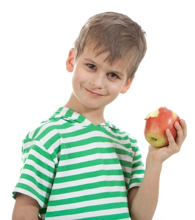 kid eat: Boy holding an apple  isolated on white background