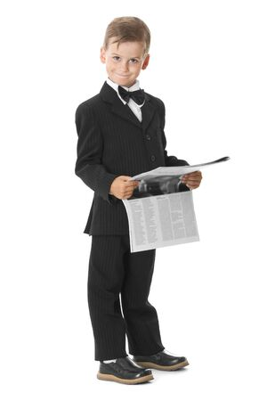 Boy holding a newspaper isolated on white background photo