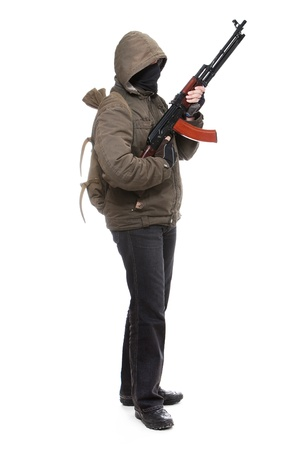 Terrorist with weapon on a white background Imagens