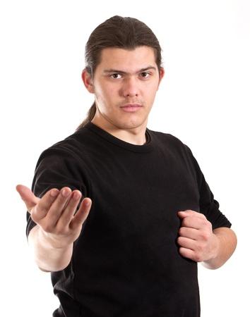 Man doing martial arts shot on white background  photo