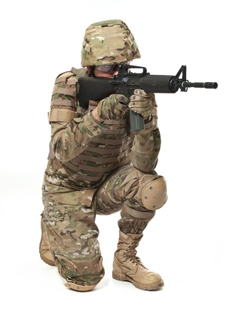 airsoft: Modern soldier with rifle isolated on a white background