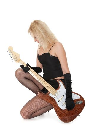 Lovely girl with electric guitar isolated over white photo