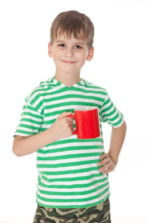 Boy holding a red cup isolated on white Stock Photo - 9116487