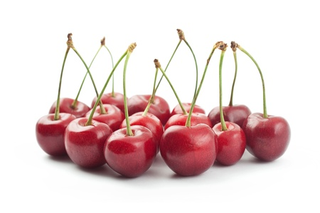 Red cherries isolated on a white background photo