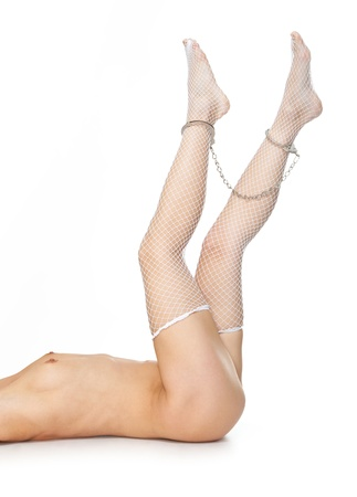 Naked sexy woman. Legs in chains - isolated. Stock Photo - 9116871