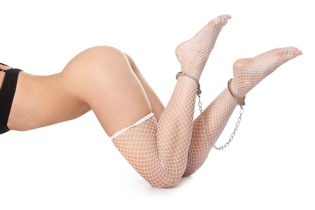 Naked sexy woman. Legs in chains - isolated. Stock Photo - 9116941