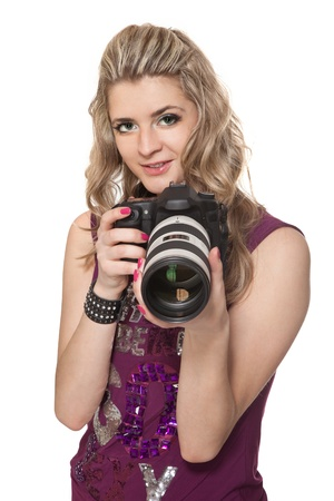Portrait of the beautiful girl with a photo camera photo
