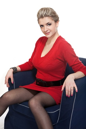 Beautiful blonde woman sitting on arm chair Stock Photo - 9116693