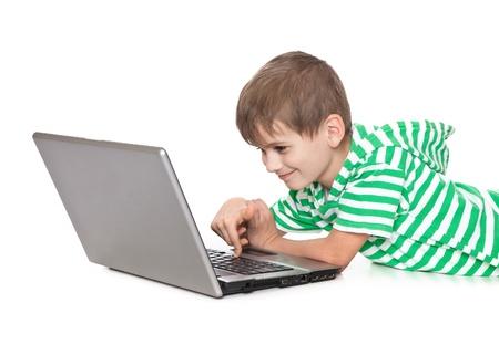 Boy holding a laptop isolated on white background photo