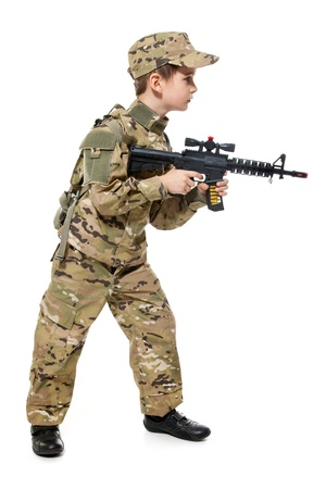 Young boy dressed like a soldier with rifle isolated on white  Stock Photo