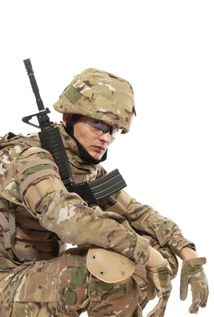 Modern soldier with rifle isolated on a white background Stock Photo - 9236014