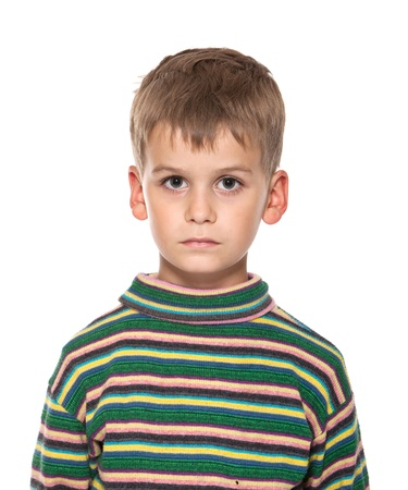 on the foreground: Cute boy anger isolated on a white background Stock Photo