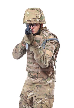 aiming: Modern soldier with rifle isolated on a white background