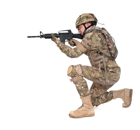 Modern soldier with rifle isolated on a white background Stock Photo - 9370850
