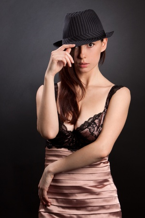 Sexy woman on a black background. Shot in a studio Stock Photo - 9374999