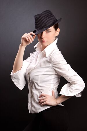 Woman wearing a hat isolated on black Stock Photo - 9374997
