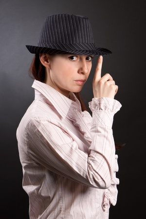 Woman wearing a hat isolated on black photo