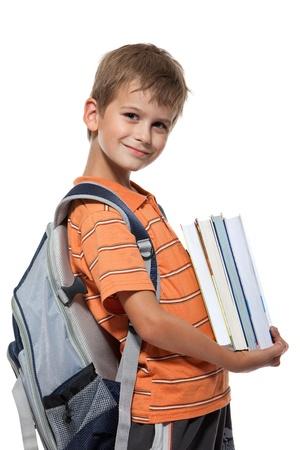 ir al colegio: Chico con libros aislados en un fondo blanco Foto de archivo