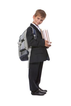 Boy holding books isolated on a white background photo