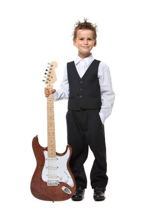 Boy holding a guitar isolated on a white background Stock Photo - 9463647