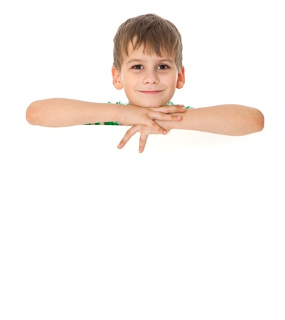 holding blank sign: Boy holding a banner isolated on white background