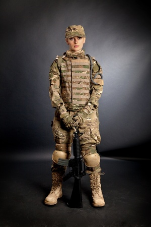 camouflage woman: Beautiful army girl with rifle isolated on black