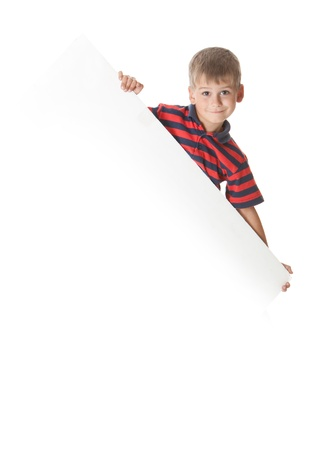 holding arm: Boy holding a banner isolated on white background