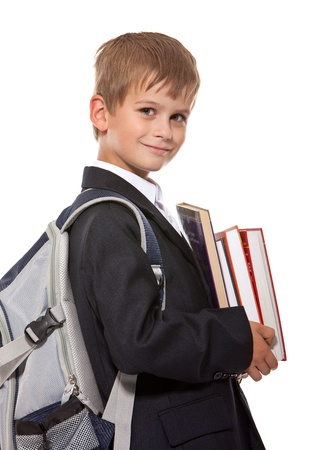 ni�os saliendo de la escuela: Ni�o sosteniendo libros aisladas sobre fondo blanco Foto de archivo