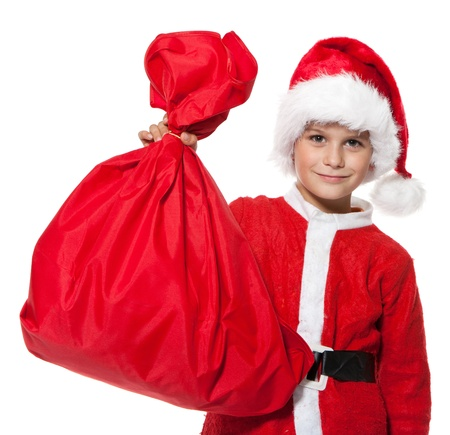 Boy holding a sack isolated on white background photo