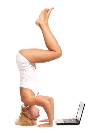 Practicing Yoga. Young woman isolated on white background photo