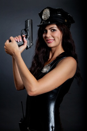 Beautiful sexy police girl with handgun and handcuffs, isolated on black background Stock Photo - 10655208