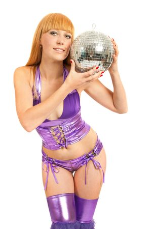Beautiful young blonde holding a big disco ball isolated on a white background photo