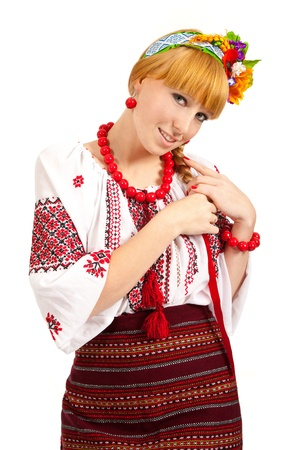 Attractive woman wears Ukrainian national dress isolated on a white background photo