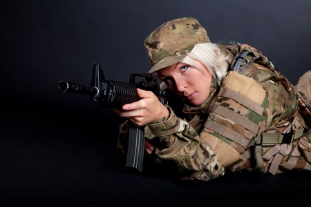 sexy army girl: Beautiful army girl with rifle isolated on black