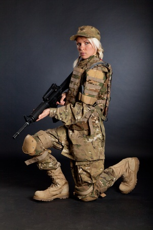 Beautiful army girl with rifle isolated on black Stock Photo - 10655101