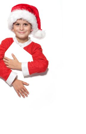 Boy holding a christmas poster isolated on white background Stock Photo - 10817371