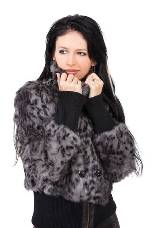 The young beautiful girl in a fur coat  isolated on white Stock Photo - 11004002